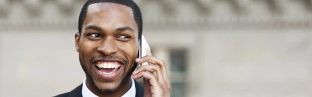 man on phone talking about his online sales training program