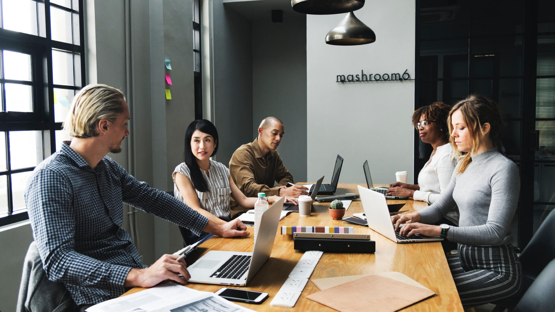 team on computers during sales training program