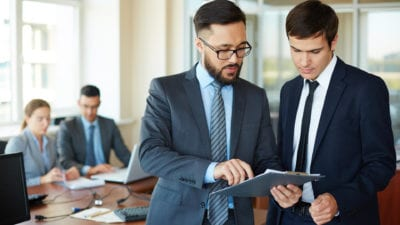 two men reviewing what their teamed learned at sales training program