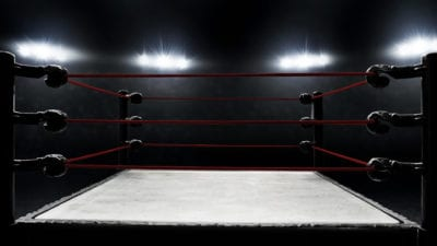 boxing arena surrounded by spotlights