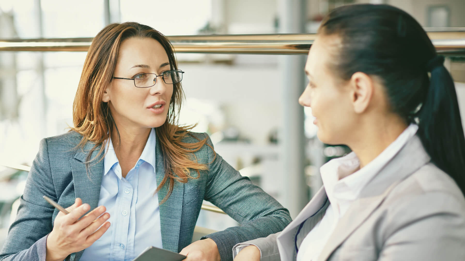 two business women discussing sales training programs